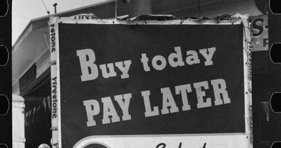 Sign saying buy today pay later from 100 years ago